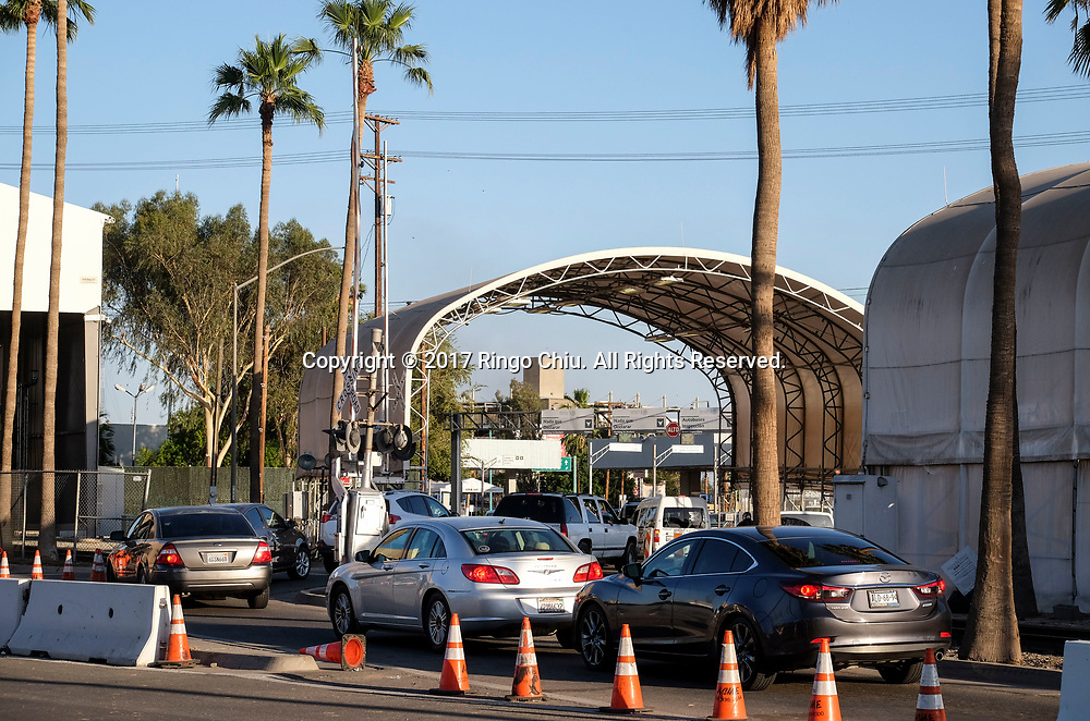 Cars wait to enter the Mexico from Calexico, California on Wednesday April 19, 2017. (Xinhua/Zhao Hanrong)(Photo by Ringo Chiu/PHOTOFORMULA.com)<br /> <br /> Usage Notes: This content is intended for editorial use only. For other uses, additional clearances may be required.