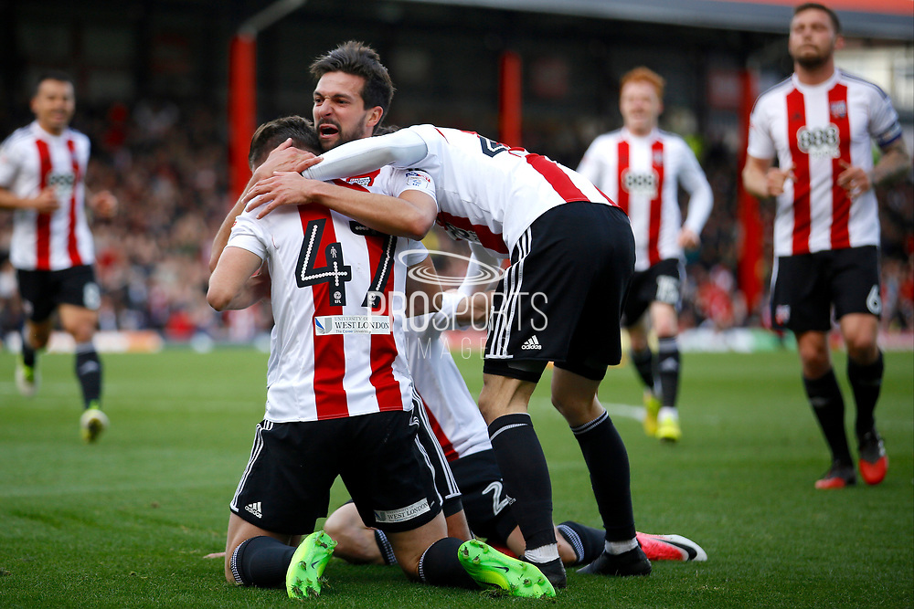Brentford players celebrate a goal from Brentford defender Yoann Barbet (29) (score 1-0) during the EFL Sky Bet Championship match between Brentford and Queens Park Rangers at Griffin Park, London, England on 22 April 2017. Photo by Andy Walter.