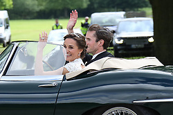 Pippa and James Matthews leave in an E type jag<br /><br />20 May 2017.<br /><br />Please byline: Vantagenews.com