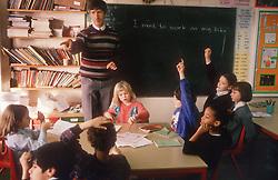 Junior school classroom with teacher and pupils,