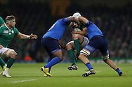 Ireland's Rory Best is stopped in his tracks by Mathieu Bastareaud (l) and Yoann Maestri of France ®. Rugby World Cup 2015 pool D match, France v Ireland at the Millennium Stadium in Cardiff, South Wales  on Sunday 11th October 2015.<br /> pic by  Andrew Orchard, Andrew Orchard sports photography.
