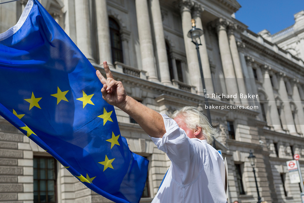 A Boris Johnson lookalike shows a Churchillian V for Victory among Pro-EU Remain protesters marching to 'Stop the Coup' in Whitehall, near Downing Street, at the end of a week that saw Prime Minister Boris Johnson ask Queen Elizabeth for permission to suspend (prorogue) the British Parliament during the final stages of his Brexit negotiations with the European Union, in Brussels, on 31st August 2019, in Westminster, London, England.