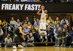 Jan 9, 2018; Morgantown, WV, USA; West Virginia Mountaineers guard Jevon Carter (2) shoots a three pointer during the first half against the Baylor Bears at WVU Coliseum. Mandatory Credit: Ben Queen-USA TODAY Sports