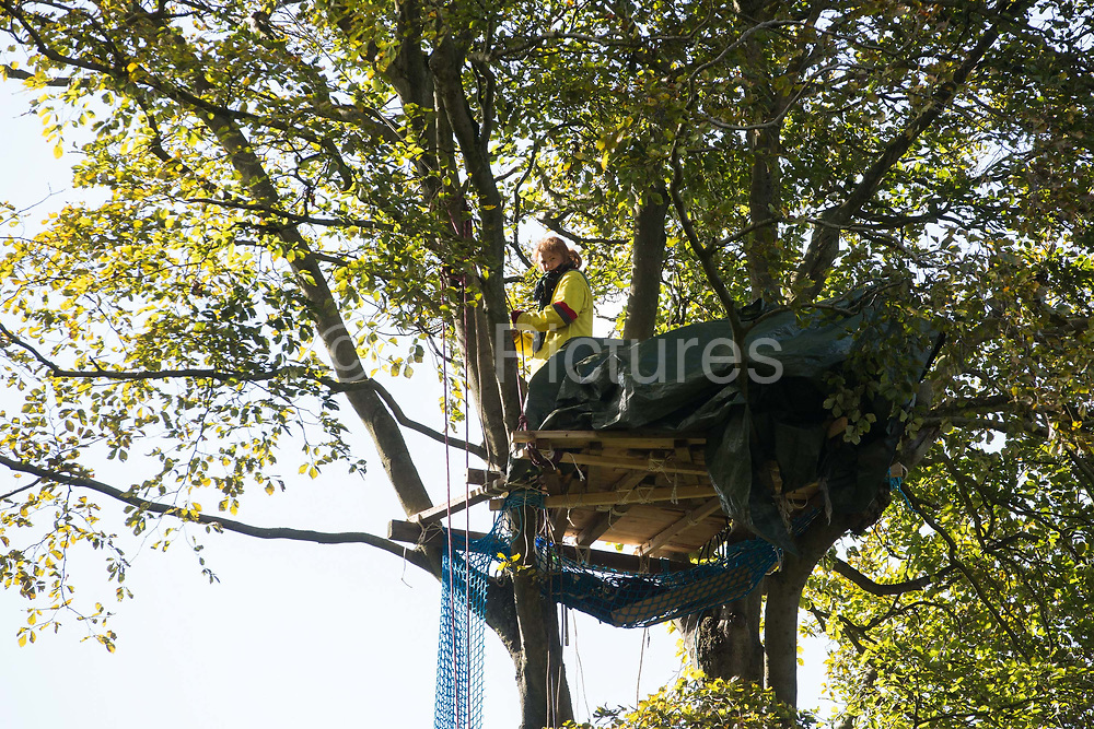 An anti-HS2 tree protector looks down from a makeshift tree house about 60 feet above ground during evictions by National Eviction Team bailiffs working on behalf of HS2 Ltd from a wildlife protection camp in the ancient woodland which inspired Roald Dahl's Fantastic Mr Fox at Jones' Hill Wood on 1 October 2020 in Aylesbury Vale, United Kingdom. Around 40 environmental activists and local residents, some of whom living in tree houses, were present during the evictions at Jones' Hill Wood which had served as one of several protest camps set up along the route of the £106bn HS2 high-speed rail link in order to resist the controversial infrastructure project.