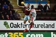 Sam Vokes of Burnley (l) and Jason Davidson of Huddersfield town jump for the ball. Skybet football league Championship match, Burnley v Huddersfield Town at Turf Moor in Burnley ,Lancs on Saturday 31st October 2015.<br /> pic by Chris Stading, Andrew Orchard sports photography.