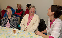 Mary Murphy and her daughter Diane enjoy a laugh with Kristin Jarvi at Gilford Parks and Recreations Senior Momentum gathering at the Gilford Fellowship Hall Monday afternoon.  (Karen Bobotas/for the Laconia Daily Sun)