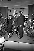 22/12/1965<br /> 12/22/1965<br /> 22 December 1965<br /> <br /> Mr. Sean Flanagan T.D.(Parliamentary Secretary to the Minister for Industry and Commerce presenting a bicycle to Mr. Peter Dunphy of Palmerstown