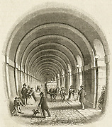'The Thames Tunnel linking Rotherhithe and Wapping, begun by Marc Isambard Brunel in 1825 and finished in 1843 after many difficulties.  Now part of the London Underground sytem. Engraving 1842.'