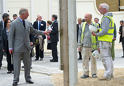 HRH The Prince of Wales visits Poundbury on the 20th Anniversary of the development. HRH The Prince of Wales walking around Poundbury,  Dorchester, Dorset, Friday 03 May, 2013, Photo by: i-Images
