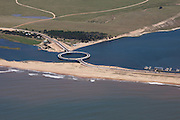 """Circular Bridge Built To Slow Down Drivers So That They Would Enjoy The View<br /> <br /> The end of 2015 saw the completion of a round bridge that stretches across Laguna Garzón between the cities of Rocha and Maldonado on the southern coast of Uruguay. Designed by Rafael Viñoly, the bridge took 12 months to complete, and replaces a traditional raft crossing while encouraging drivers to enjoy the view.<br /> """"The concept of the Puente Laguna Garzon was to transform a traditional vehicular crossing into an event that reduces the speed of the cars, to provide an opportunity to enjoy panoramic views to an amazing landscape, and at the same time create a pedestrian place in the centre,"""" said Viñoly.<br /> ©Rafael Vinoly Architects/Exclusivepix Media"""