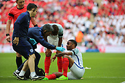 Raheem Sterling of England down injured during the FIFA World Cup Qualifier group stage match between England and Lithuania at Wembley Stadium, London, England on 26 March 2017. Photo by Matthew Redman.
