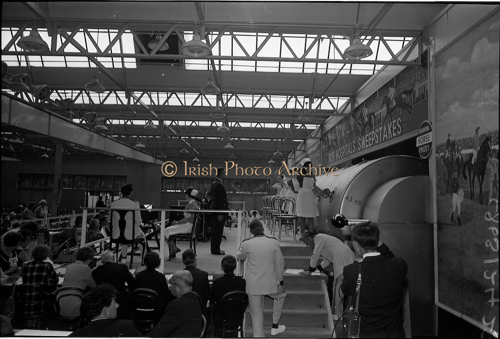 28/06/1967<br /> 06/28/1967<br /> 28 June 1967<br /> Irish Sweepstakes Derby Draw at Irish Hospital Sweepstakes office, Ballsbridge, Dublin. Image shows some of the nurses drawing numbers from the drum and waiting for Chief Superintendent J. McDonagh of Garda headquarters to take them.