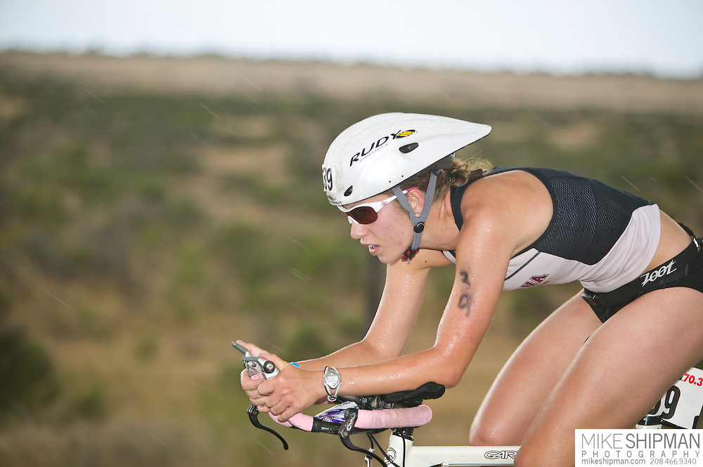 Idaho, Ada County, Boise, Boise 70.3 Ironman, Jennifer Leubke from Missoula, MT, cycles through the desert, She finished with a time of 5:05:51