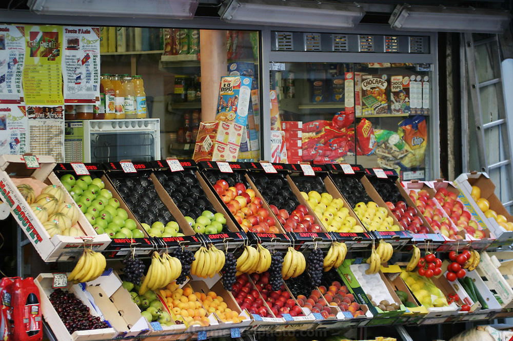 Fruit display outside a neighborhood grocery store, Paris, France.