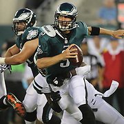 Eagles quarterback Nick Foles is sacked by Leger Douzable in action during the first quarter of the New York Jets V Philadelphia Eagles Pre Season NFL match at MetLife Stadium, East Rutherford, NJ, USA. 29th August 2013. Photo Tim Clayton
