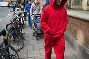 Red Playboy tracksuit and hoodie in Soho, London, England, United Kingdom. (photo by Mike Kemp/In Pictures via Getty Images)