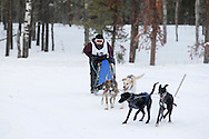 Photo Randy Vanderveen.Grande Prairie , Alberta.13-01-05.Brooke Hartrum urges her dog team through the race course as she takes part in the Four Dog -4 Mile event. The Grande Prairie Sled Dog Derby ran two days of races at Evergreen Park this past weekend, Jan. 5 and 6.