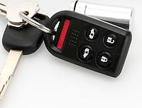 Close up of remote keyless and car keys.