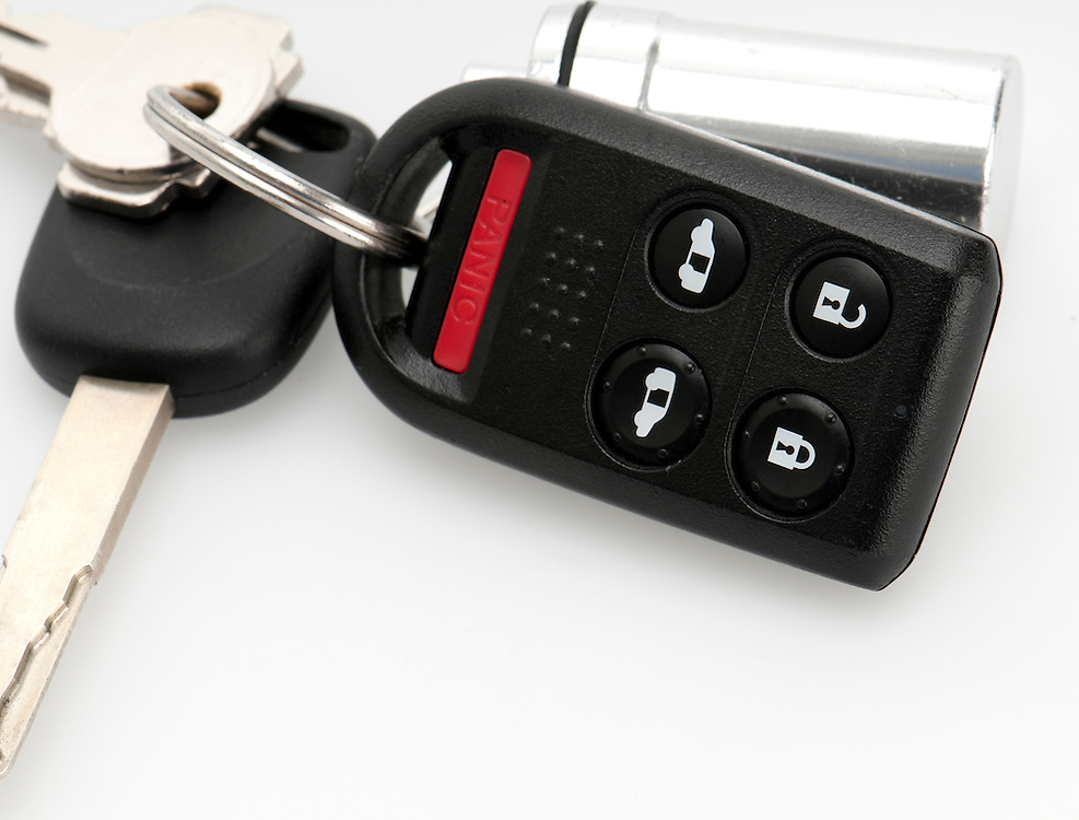 Close up of remote keyless and car keys.