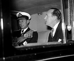 File photo dated 26/02/57 of The Duke of Edinburgh (left), accompanied by his friend and former private secretary Lieutenant-Commander Michael Parker, as he drove away from the Mansion House, London. The Duke of Edinburgh was linked to many glamorous women, but those close to Philip always insisted claims of affairs were untrue, the duke's former private secretary, Mike Parker, insisted he had been 100% faithful to the Queen. Issue date: Friday April 9, 2021.