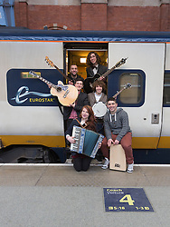 "© Licensed to London News Pictures. 04/04/2013. London, England. The winners of the 2012 busking competition run by the Mayor of London, the six-piece folk-rock band ""Jamie Thorn and the Mystery Pacific"", play to passengers at St. Pancras International before embarking on a trip to Paris for a day's busking on the Eurostar.  Photo credit: Bettina Strenske/LNP"