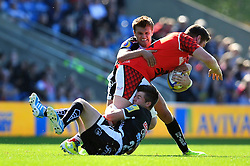 Ollie Stedman (London Welsh) is double-tackled by Henry Slade and Ceri Sweeney (Exeter Chiefs) - Photo mandatory by-line: Patrick Khachfe/JMP - Mobile: 07966 386802 06/09/2014 - SPORT - RUGBY UNION - Oxford - Kassam Stadium - London Welsh v Exeter Chiefs - Aviva Premiership