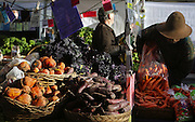 Beets at Nash's Organic Produce glow in the sunshine at the Ballard Farmers Market. (Ken Lambert / The Seattle Times)
