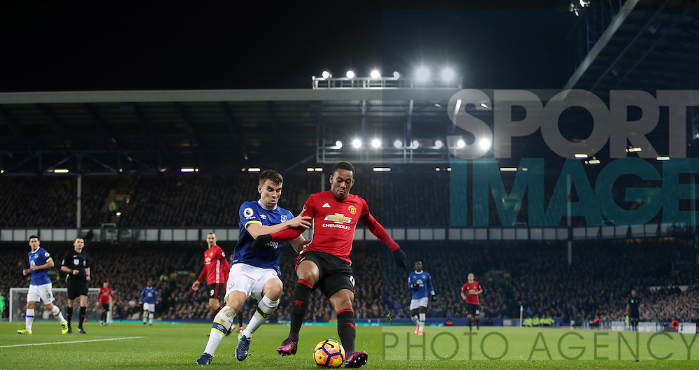 Seamus Coleman of Everton and Anthony Martial of Manchester United during the Premier League match at Goodison Park, Liverpool. Picture date: December 4th, 2016.Photo credit should read: Lynne Cameron/Sportimage
