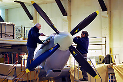 "© Licensed to London News Pictures. File picture dated 13/12/2012. Bristol, UK. Peter Dean and Keith Sands work on a Mark IX Spitfire. Engineers race to finish work rebuilding a Mark IX Spitfire fighter circa 1943, at Filton airfield near Bristol. The plane has been rebuilt  by John Hart engineering, it is the last plane to be completed at the airfield and was flown out on 18 December 2012 by pilot Bill Perrins. Filton, the birthplace of the British-built Concorde jets, is to close on Friday (21st December 2012). Its owner BAE Systems says it is not viable and intends to sell it for housing and business development. BAE Systems said the airfield was closing following a comprehensive assessment over a five-year period and an independent review, ""both of which concluded that the airfield was not economically viable"".  Airbus has said it is fully committed to the Filton site, where it has a base making aircraft wings.  A spokesman said: ""The closure of the airfield will have no significant effect on our business and we have mitigation plans in place regarding the change of venue for our passenger shuttle (using Bristol airport) and the transportation of the A400M wings (via Portbury docks).  Planes currently based at Filton will have to find new homes. The airfield officially closes for flights this Friday, though the police helicopter will still be based there. BAE is supporting a new museum at Filton to ""house Concorde Alpha-Foxtrot and Bristol's aviation heritage."".Photo credit : Simon Chapman/LNP"