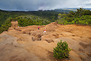Tourists hike the Pihea Trail on the north rim of the Alakai Plateau in Kokee State Park, Kauai, Hawaii.