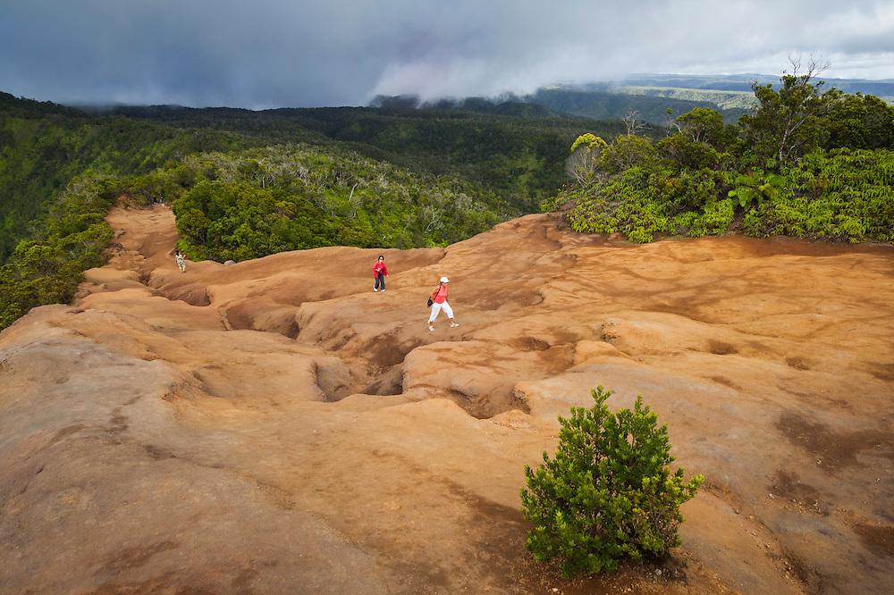 Tourists hike the Pihea Trail on the north rim of the Alakai Plateau in Kokee State Park, Kauai, Hawaii.