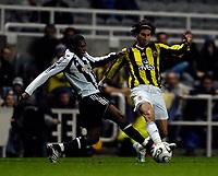 Photo: Jed Wee.<br /> Newcastle United v Fenerbahce. UEFA Cup. 19/10/2006.<br /> <br /> Fenerbahce's Mehmet Yozgatli (R) is tackled by Newcastle's Charles N'Zogbia.