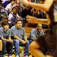 011814  Adron Gardner/Independent<br /> <br /> Gallup Bengal girls varsity coach Kamau Turner, right, coaches from the sideline as the Bengals too on the  Cibola Cougars at Gallup High School in Gallup Saturday.