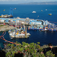 ISOLA DEL GIGLIO, ITALY - SEPTEMBER 16: The Costa Concordia is readied for a salvage operation on September 16, 2013 in Isola del Giglio, Italy. Work begins today to right the stricken Costa Concordia vessel, which sank on January 12, 2012. If the operation is successful, it will then be towed away and scrapped. The procedure, known as parbuckling, has never been carried out on a vessel as large as Costa Concordia before. (Photo by Marco Secchi/Getty Images)