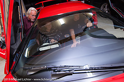 Arlen Ness looks a bit reluctant as his grandsons Max and Zach check the fit and feel of Arlen's new Lamborghini Diablo. Dublin, CA. 2004. Photograph ©2004 Michael Lichter