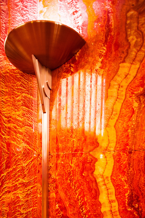A  streamlined, Art Deco light fixture in the red, Moroccan marble-lined lobby of the Chrysler Building
