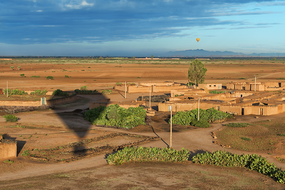 Hot-air balloon shadow over rural Marrakech, Morocco.