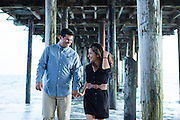 Marissa Susbilla and Zachary Canez pose for their portraits during their engagement session at Santa Cruz Beach Boardwalk in Santa Cruz, California, on April 17, 2014. (Stan Olszewski/SOSKIphoto)<br />