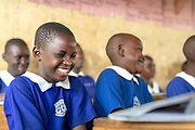 Group of laughing school children in class, The Musoto Christian School, Uganda