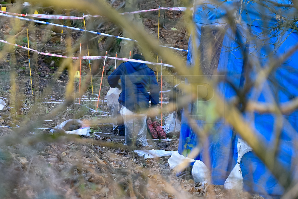 """© Licensed to London News Pictures. 09/12/2019. Gerrards Cross, UK. A police officer holds an evidence bag during a finger tip search of ground in woodland as the Metropolitan Police Service continues a search operation in Gerrards Cross, Buckinghamshire. Police have been in the area conducting operations on Hedgerley Lane since Thursday 5th December 2019. In a press statement issued on 7th December a Metropolitan Police spokesperson said """"Officers are currently in the Gerrards Cross area of Buckinghamshire as part of an ongoing investigation.<br /> """"We are not prepared to discuss further for operational reasons."""" No further updates have been issued. Photo credit: Peter Manning/LNP"""