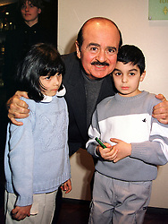 Middle eastern businessman MR ADNAN KHASHOGGI and his children SAMIHA and KAMAL, at a party in London on 14th March 2000.OCB 30