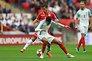 Dele Alli of England is intercepted by Bjorn Kristensen of Malta. FIFA World cup qualifying match, european group F, England v Malta at Wembley Stadium in London on Saturday 8th October 2016.<br /> pic by John Patrick Fletcher, Andrew Orchard sports photography.