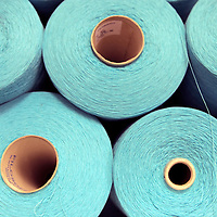 Europe, Ireland, Avoca. Blue spools of wool at Avoca Handweavers Mill, County Wicklow.