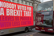 On the day that Prime Minister Theresa Mays Meaningful Brexit vote is taken in the UK Parliament, a touring lorry Brexit ad drives along Whitehall to the amusement of bus tourists, on 15th January 2019, in Westminster, London, England.