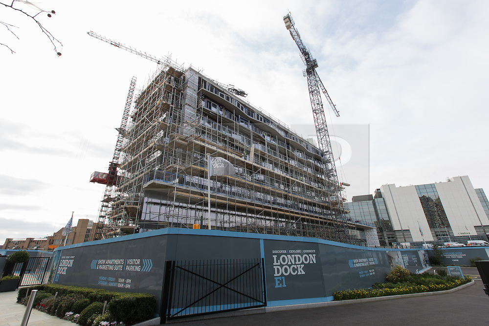 © Licensed to London News Pictures. 17/02/2016. London, UK. Construction work at the main London Dock site in Pennington Street. London Dock is a residential mixed-use development on the 15 acre site of the former News International (now News UK) which has been fully demolished except for the listed Pennington Street warehouse and Times House, which is being refurbished . When fully completed, 486 of the 1,800 new homes will be affordable, with 274 affordable and social rented homes and 212 homes for first time buyers. Photo credit : Vickie Flores/LNP