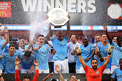 Manchester City's Vincent Kompany lifts the Community Shield trophy after the Community Shield match at Wembley Stadium, London.