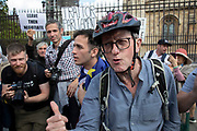 Member of the public gets into a fierce debate with pro Brexit protesters in Westminster on the day after Parliament voted to take control of Parliamentary proceedings and prior to a vote on a bill to prevent the UK leaving the EU without a deal at the end of October, on 4th September 2019 in London, England, United Kingdom. Yesterday Prime Minister Boris Johnson faced a showdown after he threatened rebel Conservative MPs who vote against him with deselection, and vowed to aim for a snap general election if MPs succeed in a bid to take control of parliamentary proceedings to allow them to discuss legislation to block a no-deal Brexit.