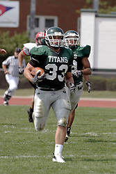 09 September 2006 Titan Linebacker Steve Groetsema sprints to the end zone on one of his interceptions.  This one was cancelled due to an illegal block in the back...In the first ever football competition between the Olivet Comets and the Illinois Wesleyan Titans, the Titans strut off the field with a 21- 6 victory. .Game action took place at Wilder Field on the campus of Illinois Wesleyan University in Bloomington Illinois.