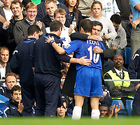 Photo: Daniel Hambury.<br />Chelsea v Blackburn Rovers. The Barclays Premiership.<br />29/10/2005.<br />Chelsea's Joe Cole getrs a hug from manager, Jose Mourinho.