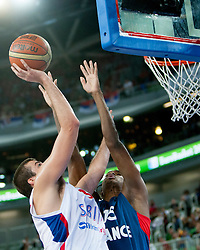 Nemanja Bjelica #8 of Serbia vs Mickael Gelabale #15 of France during basketball match between National teams of France and Serbia in 2nd Round at Day 12 of Eurobasket 2013 on September 14, 2013 in SRC Stozice, Ljubljana, Slovenia. (Photo By Urban Urbanc / Sportida)